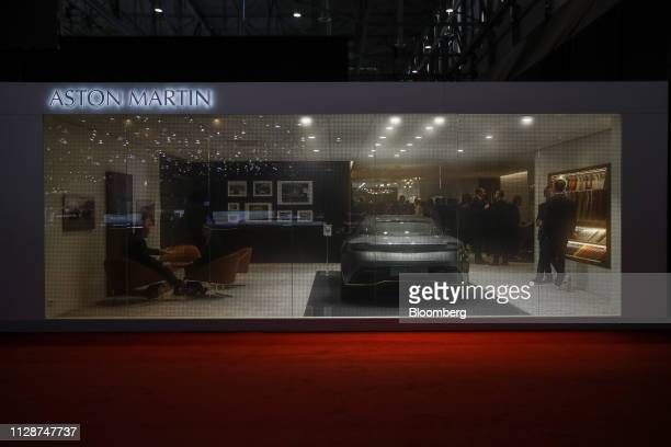 Attendees visit the Aston Martin Lagonda Global Holdings Plc exhibition stand on the opening day of the 89th Geneva International Motor Show in...