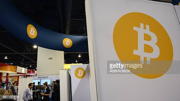Attendees visit the Bitcoin stand January 6 2015 at the Consumer Electronics Show in Las Vegas Nevada AFP PHOTO / ROBYN BECK