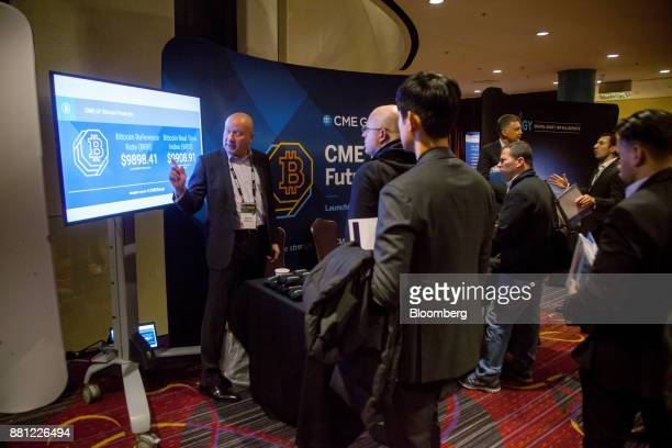 Attendees visit the CME Group Inc booth during the Consensus Invest event in New York US on Tuesday Nov 28 2017 Consensus Invest the world's first...