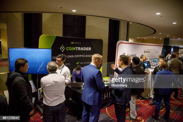 Attendees visit the Cointrader Exchange Inc booth during the Consensus Invest event in New York US on Tuesday Nov 28 2017 Consensus Invest the...