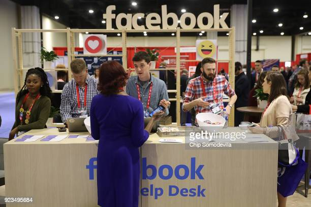 Attendees visit the Facebook Help Desk inside the Conservative Political Action Conference Hub at the Gaylord National Resort and Convention Center...
