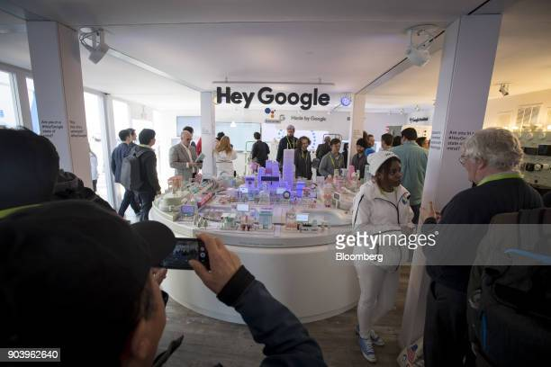 Attendees visit the Google Inc booth during the 2018 Consumer Electronics Show in Las Vegas Nevada US on Thursday Jan 11 2018 Electric and driverless...