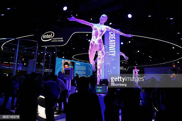 Attendees visit the Intel Corp booth during the 2016 Consumer Electronics Show in Las Vegas Nevada US on Wednesday Jan 6 2016 CES is expected to...