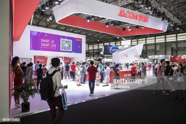 Attendees visit the JDcom Inc booth at the Consumer Electronics Show Asia in Shanghai China on Wednesday June 7 2017 The show runs through June 9...