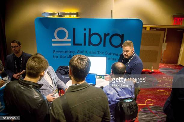 Attendees visit the Libra booth during the Consensus Invest event in New York US on Tuesday Nov 28 2017 Consensus Invest the world's first digital...