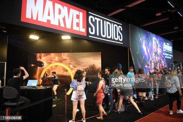"""Attendees visit the Marvel Studios booth at the D23 Expo, billed as the """"largest Disney fan event in the world,"""" August 23, 2019 at the Anaheim..."""