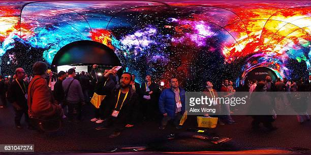 Attendees visit the OLED Tunnel at the LG booth during CES 2017 at the Las Vegas Convention Center on January 5 2017 in Las Vegas Nevada CES the...