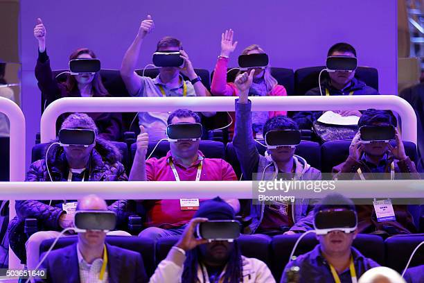 Attendees visit the The Oculus Gear VR Theater with 4D during the 2016 Consumer Electronics Show in Las Vegas Nevada US on Wednesday Jan 6 2016 CES...