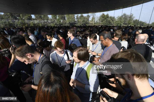 Attendees wait ahead an event at the Steve Jobs Theater in Cupertino California US on Tuesday Sept 12 2017 Apple plans to unveil three phonesanother...