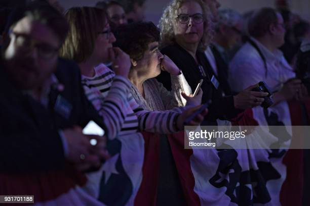 Attendees wait during an election night rally with Conor Lamb Democratic candidate for the US House of Representatives not pictured in Canonsburg...