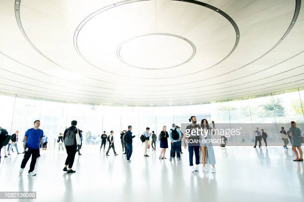 Attendees wait for a product announcement event to begin at the Apple Cupertino California headquarters on September 12 2018 New iPhones set to be...