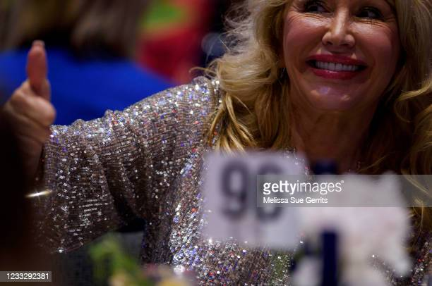 Attendees wait for former U.S. President Donald Trump to address the NCGOP state convention on June 5, 2021 in Greenville, North Carolina. The event...