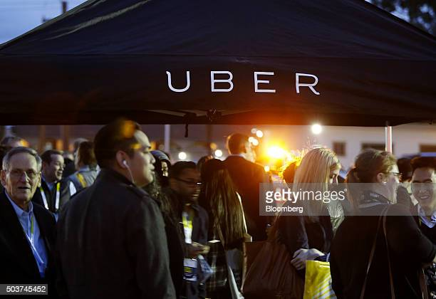 Attendees wait for rides in the Uber Technologies Inc area during the 2016 Consumer Electronics Show in Las Vegas Nevada US on Wednesday Jan 6 2016...