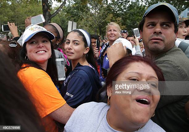 Attendees wait for the arrival of Pope Francis at the Mass for the conclusion of the World Meeting of Families on Benjamin Franklin Parkway September...