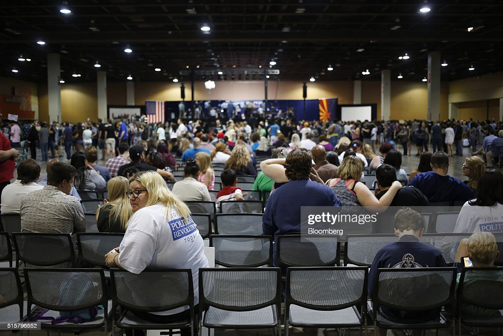 Attendees wait for the start of a campaign event for Senator Bernie Sanders, an independent from Vermont and 2016 Democratic presidential candidate, not pictured, in Phoenix, Arizona, U.S., on Tuesday, March 15, 2016. In Democratic forums, Sanders and Hillary Clinton argue that deportations are ripping apart hard-working undocumented people who are merely trying to make a good life for their families, and that the president must show them mercy, even if it means stretching the limits of the law. Photographer: Luke Sharrett/Bloomberg via Getty Images