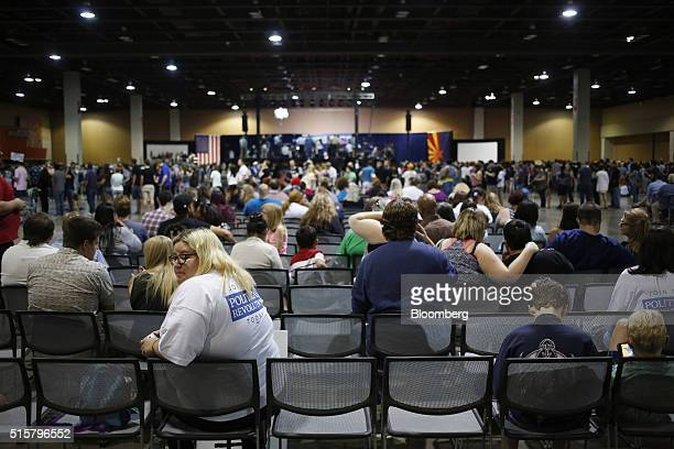 Attendees wait for the start of a campaign event for Senator Bernie Sanders an independent from Vermont and 2016 Democratic presidential candidate...