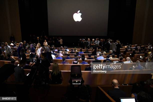 Attendees wait for the start of an event at the Steve Jobs Theater in Cupertino California US on Tuesday Sept 12 2017 Apple plans to unveil three...