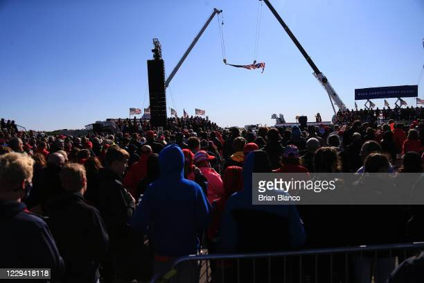Attendees wait for the start of U.S. President Donald Trump's remarks at a campaign rally at Fayetteville Regional Airport on November 2, 2020 in...