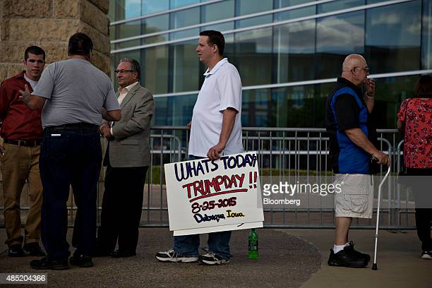 Attendees wait in line ahead of an event with Donald Trump president and chief executive of Trump Organization Inc and 2016 Republican presidential...