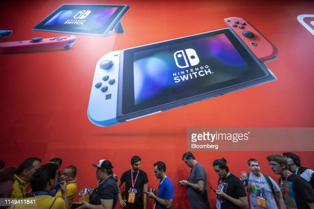 Attendees wait in line at the Nintendo Co. Luigi's Mansion 3 for Nintendo Switch booth during the E3 Electronic Entertainment Expo in Los Angeles,...