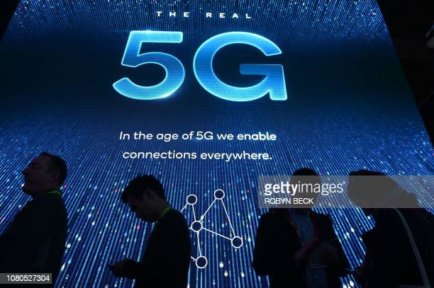 Attendees wait in line for a 5G exhibition at the Qualcomm booth during CES 2019 consumer electronics show on January 10 2019 at the Las Vegas...