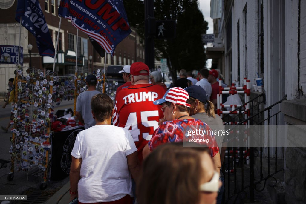 Attendees wait in line outside a rally with U.S. President Donald Trump in Evansville, Indiana, U.S., on Thursday, Aug. 30, 2018. Trump rejected a European Union offer to scrap tariffs on cars, likening the bloc's trade policies to those of China. Photographer: Luke Sharrett/Bloomberg via Getty Images
