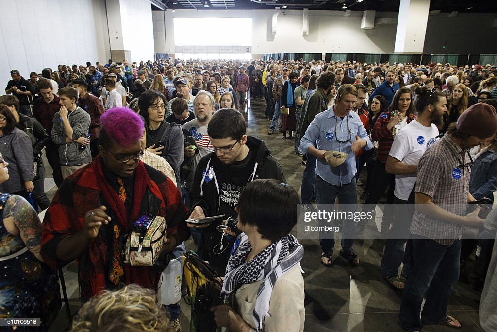 Attendees wait in line to enter a campaign event for Senator Bernie Sanders, an independent from Vermont and 2016 Democratic presidential candidate, at the Colorado Convention Center in Denver, Colorado, U.S., on Saturday, Feb. 13, 2016. In the first Democratic debate on Thursday since her crushing defeat in New Hampshire, Hillary Clinton tried a new approach to win back wavering supporters, capturing Bernie Sanders anger without looking angry. Photographer: Matthew Staver/Bloomberg via Getty Images