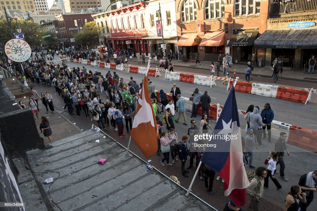 Attendees wait in line to enter a venue on 6th street at the 2017 South By Southwest (SXSW) Interactive Festival in Austin, Texas, U.S., on Tuesday, March 14, 2017. The SXSW Interactive Festival features a variety of tracks that allow attendees to explore what's next in the worlds of entertainment, culture, and technology. Photographer: David Paul Morris/Bloomberg via Getty Images