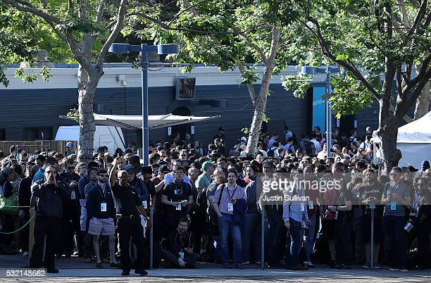 Attendees wait in line to enter Google I/O 2016 at Shoreline Amphitheatre on May 19 2016 in Mountain View California Google CEO Sundar Pichai will...