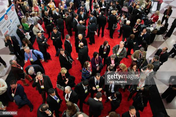Attendees wait to attend a seminar during the National Retail Federation annual convention and expo at the Jacob K Javits Convention Center January...