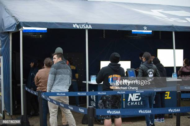 PENSACOLA FL DECEMBER Attendees wait to compete in the USAA Next Level Challenge during Base*FEST Powered by USAA on December 15 2017 at Naval Air...