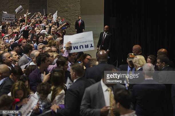Attendees wait to greet Donald Trump president and chief executive of Trump Organization Inc and 2016 Republican presidential candidate right during...