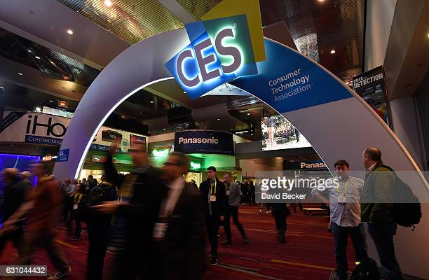 Attendees walk by an illuminated CES sign at CES 2017 at the Las Vegas Convention Center on January 5 2017 in Las Vegas Nevada CES the world's...