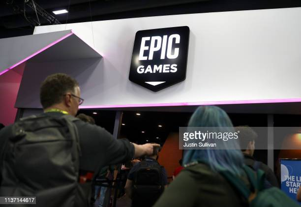 Attendees walk by the Epic Games booth at the 2019 GDC Game Developers Conference on March 20 2019 in San Francisco California The GDC runs through...