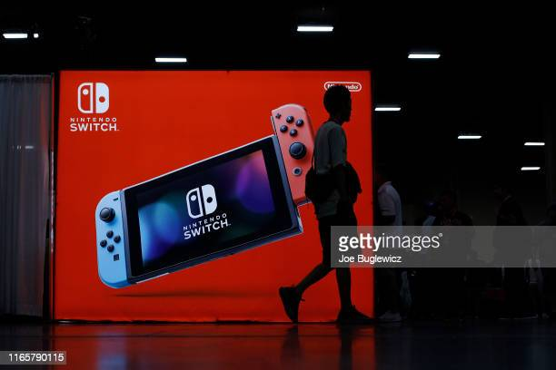 Attendees walk by the Nintendo booth during day one of the 2019 Evolution Championship Series at Mandalay Bay Resort and Casino on August 02, 2019 in...