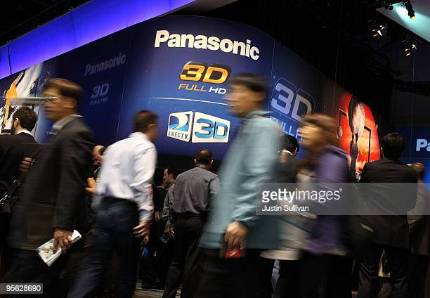 CES attendees walk by the Panasonic booth at the 2010 International Consumer Electronics Show at the Las Vegas Hilton January 7 2010 in Las Vegas...
