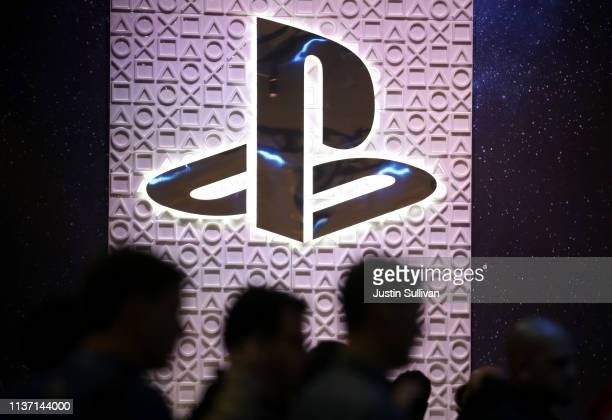 Attendees walk by the Sony PlayStation booth at the 2019 GDC Game Developers Conference on March 20, 2019 in San Francisco, California. The GDC runs...