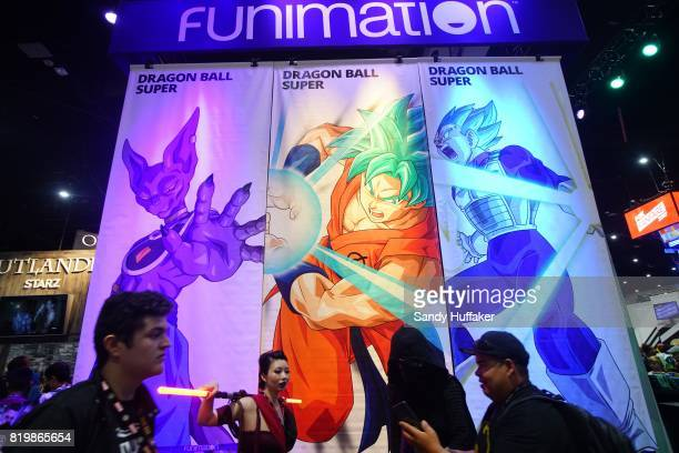 Attendees walk in front of the Funimation boothd at the San Diego Convention Center during Comic Con International on July 20 2017 in San Diego...