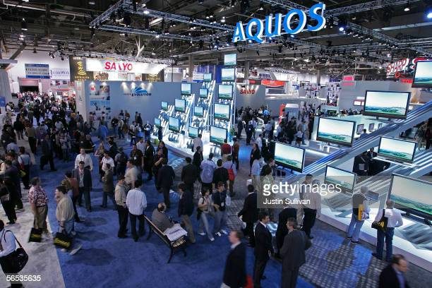 Attendees walk on the floor of the 2006 Consumer Electronics Show January 6 2006 in Las Vegas Nevada The 16 million square foot consumer electronics...