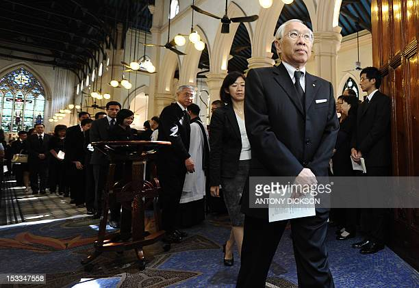Attendees walk out of the Saint John's Anglican church after a rememberance service for the 38 victims of a ferry collision in Hong Kong on October 4...