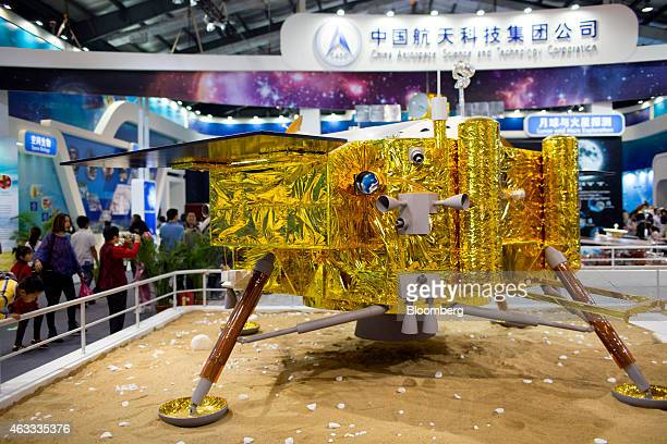 Attendees walk past a China Aerospace Science and Technology Corp Chang'e 3 lunar lander during the China International Aviation Aerospace Exhibition...