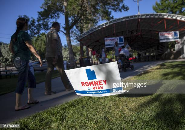 Attendees walk past a sign during a campaign stop for Mitt Romney Republican US Senate candidate in Draper Utah US on Friday June 22 2018 Romney the...