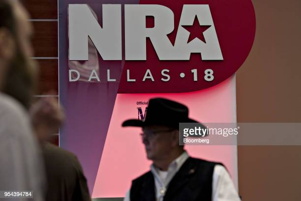 Attendees walk past signage inside the Kay Bailey Hutchison Convention Center ahead of the National Rifle Association annual meeting in Dallas Texas...