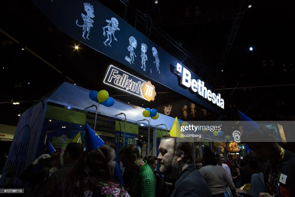 Attendees walk past the Bethesda Softworks LLC booth during