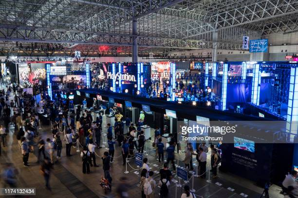 Attendees walk past the Sony Interactive Entertainment Inc. Booth on the business day of the Tokyo Game Show 2019 at Makuhari Messe on September 12,...