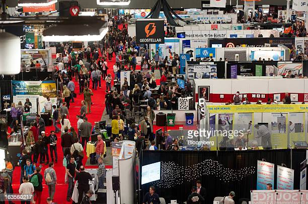 Attendees walk the floor of the Austin Convention Center at the South By Southwest Conference in Austin Texas US on Monday March 11 2013 The 20th...