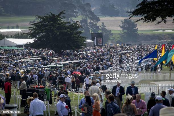 Attendees walk the grounds during the 2018 Pebble Beach Concours d'Elegance in Pebble Beach, California, U.S., on Sunday, Aug. 26, 2018. More than...