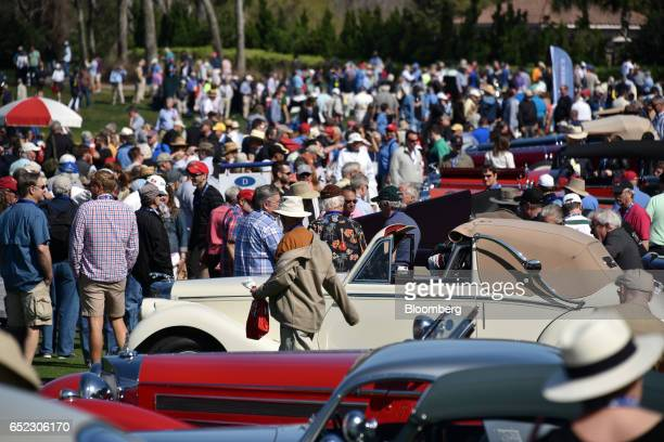 Attendees walk through the 2017 Amelia Island Concours d'Elegance in Amelia Island Florida US on Saturday March 11 2017 The Amelia Island Concours...