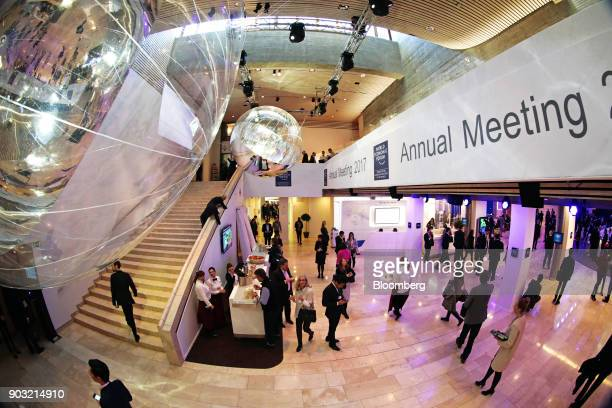 Attendees walk through the Congress Center between sessions in Davos Switzerland on Friday Jan 20 2017 President Donald Trump will dominate the Davos...