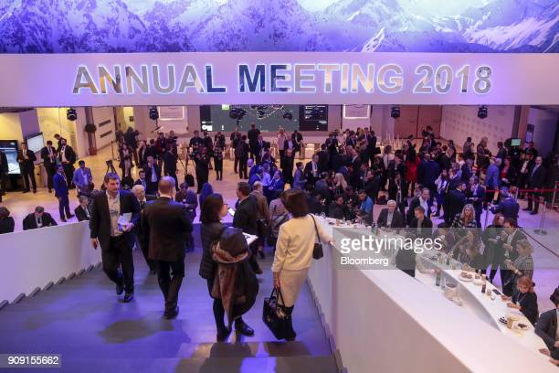 Attendees walk through the Congress Center between sessions on the opening day of the World Economic Forum in Davos Switzerland on Tuesday Jan 23...